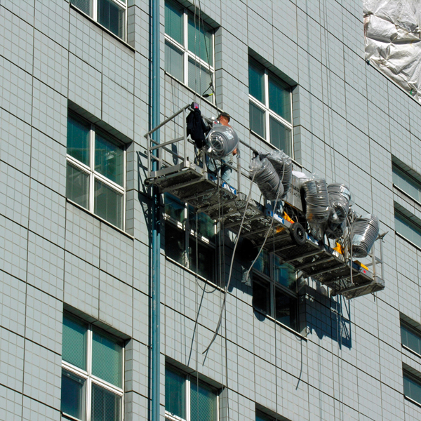 Engineers investigate a building facade
